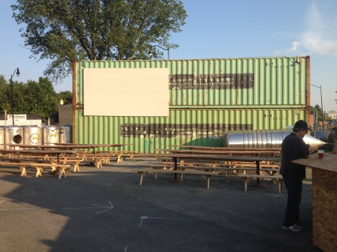Steel Container Boxes that will House Bathrooms Inside.  Note the Large Screen that Movies will be Projected Onto.