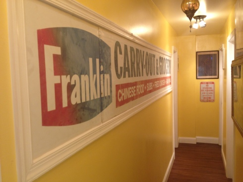 Franklin Carryout Sign Preserved on the Wall at Indigo