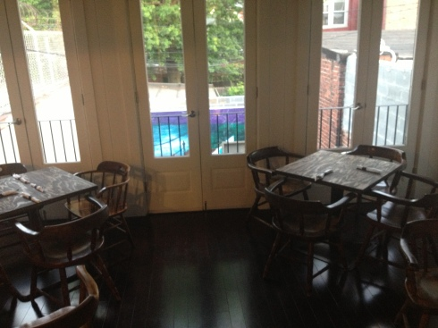 Tables on Second Floor Overlooking Patio at Po Boy Jim