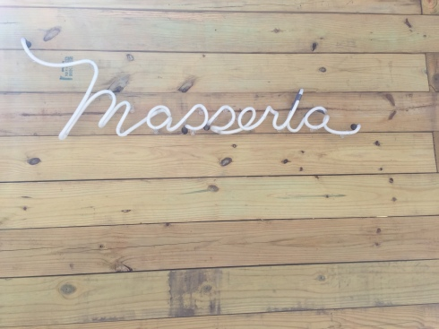 Sign Posted Outside of Masseria Near Union Market